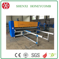 High speed honeycomb paperboard slitting machine